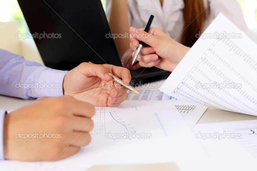 Financial and business documents on the table and human hands — Stock Photo #6193015