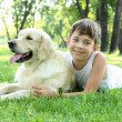 Little boy in the park with a dog - Stock Photo