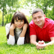 Young couple in the park — Stock Photo