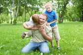 Portrait of father with two sons outdoor — Stock Photo