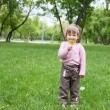 Portrait of a little girl outdoors - Stock Photo
