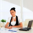 Young business woman in the office — Stock Photo #6211949