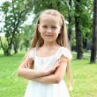 Portrait of a little girl in the park - Stock Photo