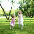 Two little sisters in the summer park — Stock Photo #6212123