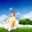 Portrait of a young woman meditating on nature - Stock Photo