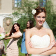 Young bride in white wedding dress - Stok fotoraf