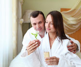 Young couple with flower — Stock Photo