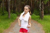 Young woman doing sport outdoors — Photo