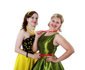 Two young woman in bright colour dresses — Stock Photo