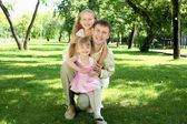 Father with two daugthers outside — Stock Photo