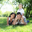 Stock Photo: Family together in the summer park