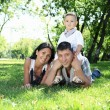 Family together in the summer park — Stock Photo
