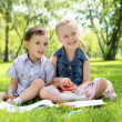 Children in the park reading a book — Stock Photo #6247582