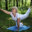 An elderly woman practices yoga — Stock Photo #6257907