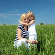 Mother with her daughter outdoors - Foto Stock