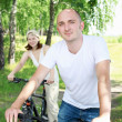 Young man riding a bike — Stock Photo