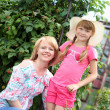 Stock Photo: Mother and daughter gardening together