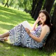 Portrait of pregnant woman in the park — Stock Photo