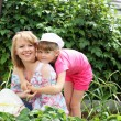 Mother and daughter gardening together — Stock Photo #6273150