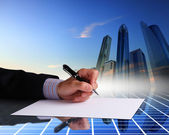 Businessman hand signing documents — Stock Photo