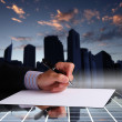 Businessman hand signing documents - Stockfoto