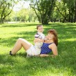 Stock Photo: Mother with little son in the park