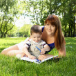Mother with little son in the park — Stock Photo
