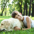 Royalty-Free Stock Photo: Little boy in the park with a dog