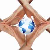 Human hand and symbol of our planet — Stock Photo