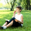 Royalty-Free Stock Photo: Portrait of a boy with a book in the park