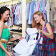 Girl seller helps shoppers — Stock Photo #6323607