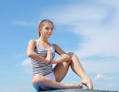 Portrait of a young woman doing exercises — Stock Photo