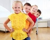 Group classmates standing in a row — Stock Photo