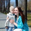 Young boy and his mother walks in the park — Stock Photo