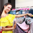 Beautiful young girl at the store — Stock Photo #6346757
