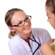 Doctor doing medical examination to a child — Stock Photo #6461785