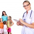 Doctor and family with children — Stock Photo #6461844