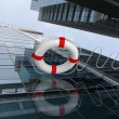 Rescue ring against skyscrapers — Stock Photo