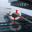 Rescue ring against skyscrapers — Stock Photo #6461966