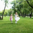 Two little sisters in the summer park — Stock Photo #6462066