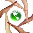 Human hand and symbol of our planet - Stock Photo