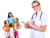 Doctor and family with children — Stock Photo