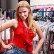 Beautiful young girl at the store - Stock Photo