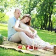 Young couple on picnic in the park — Photo