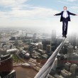 Business man balancing on the rope - Stockfoto