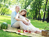 Young couple on picnic in the park — Стоковое фото