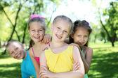 Children playing in the summer park — ストック写真