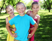 Children playing in the summer park — Stock Photo