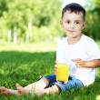 Portrait of a little boy in the park — Stock Photo