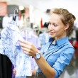 Stock Photo: Woman in a shop buying clothes